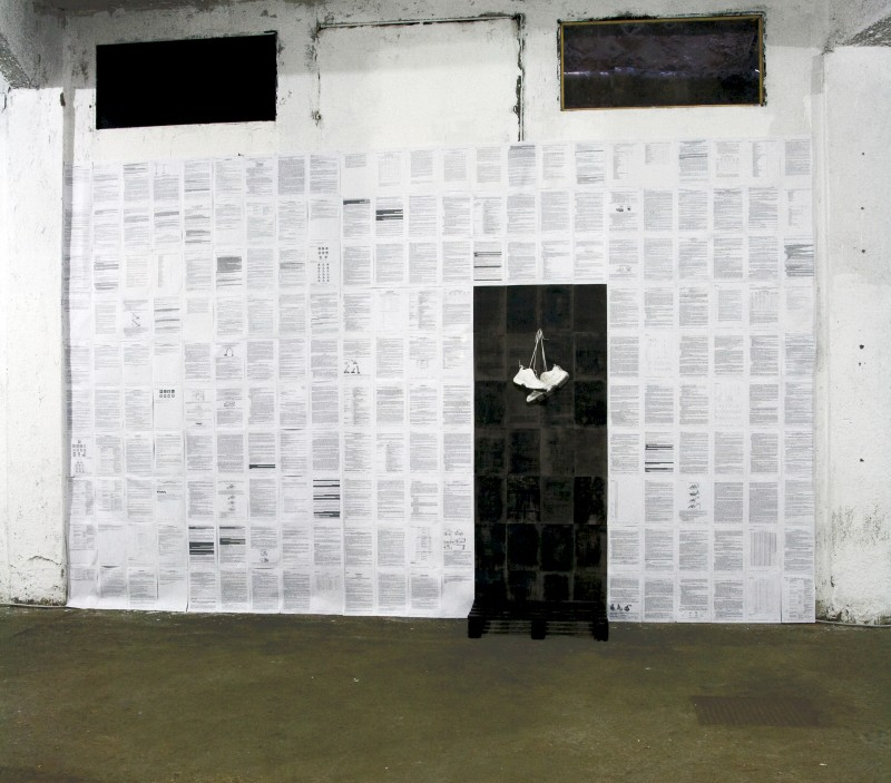 Alessio Ancillai, TUSL with shoes, 2010, papers of the Testo Unico sulla Sicurezza sul Lavoro, shoes, pallets, mixed media, site-specific installation, photo credit: Mauro Piccinini