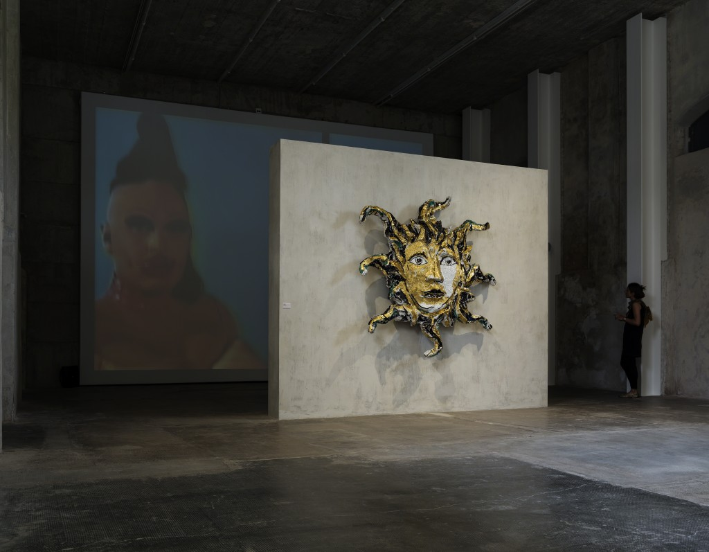 Lucio Fontana Testa di medusa 1948-1954 In the background: Charles Atlas Teach 1992-1998 Exhibition view of 'In Part' curated by Nicholas Cullinan Fondazione Prada Milano 2015 Photo Attilio Maranzano Courtesy Fondazione Prada